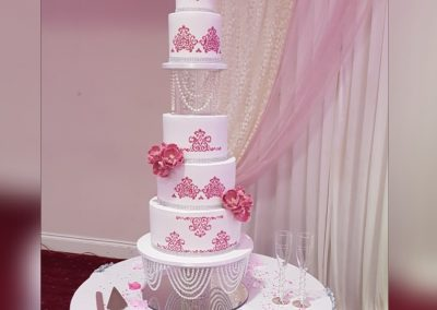 Wedding Cake - Split 5 tier cake with pink decor, pink flowers and pearl divider