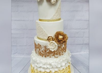 Wedding Cake - 4 tier with gold and white flowers and decorated base