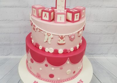 1st Birthday Cake - 2 tier - building blocks top - baby clothes and patterns