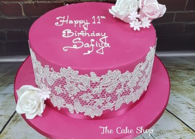 Birthday Cake - Pink cake with white lace and flowers