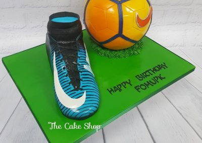 Birthday Cake - Football boot with orange football on green board
