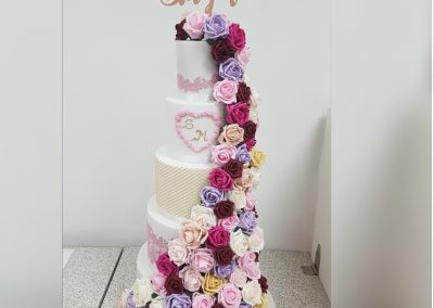 Wedding Cake - 5 Tier - Floral drape top to bottom pink, purple and red roses