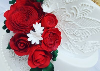 Wedding Cake - 4 tier - Gold glitter with red rose bouquets and pearl leaf decor