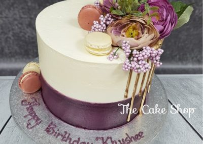 Birthday Cake with - purple base, cream with macaron decoration and organza flowers